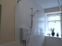 Rented property install hygeinic cladding to wall and new shower unit