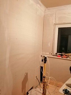 Kitchen converted to snug/office, plastering